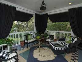 Black patio awnings and summer drapes provide ample shade.