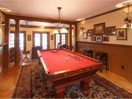 "Spacious billiard room with a ""parlor"" feel."