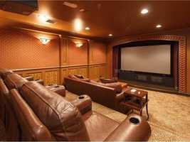 Glamorous home theater with plush seating.