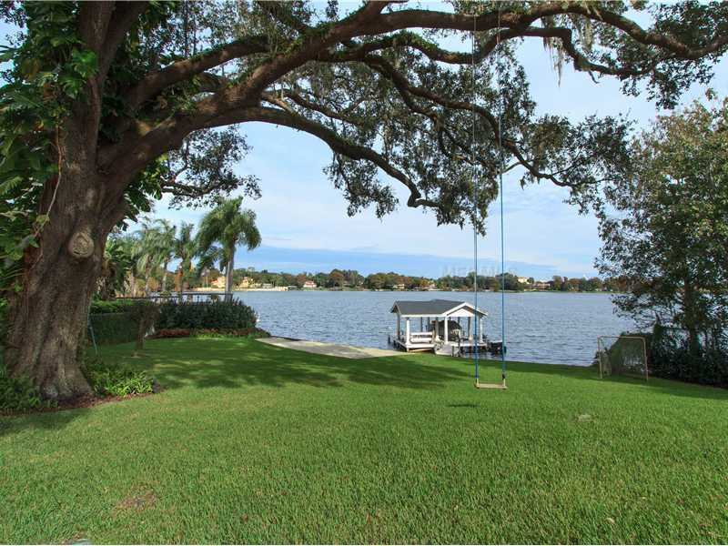 Enjoy Lake Concord with a private sand beach and boat dock.