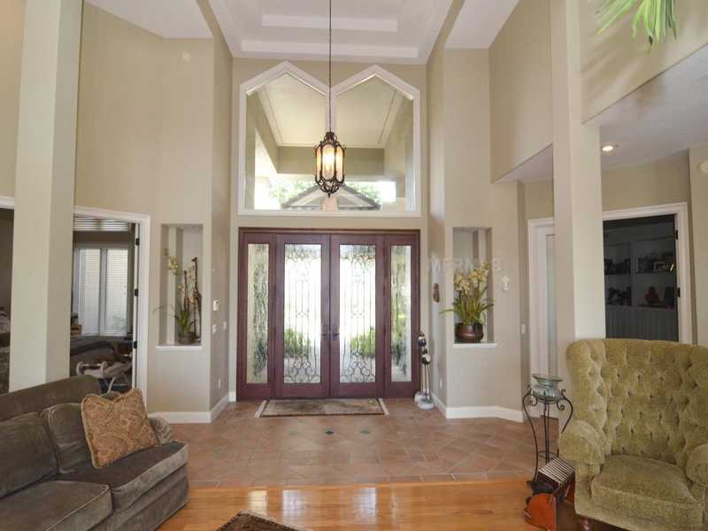 Step inside the home and you'll find a open foyer, which leads to an open layout throughout the home.