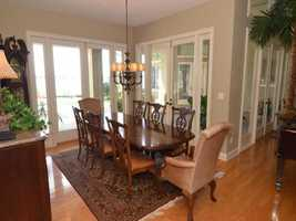 Enjoy the fresh lake breeze while entertaining in the formal dining room.