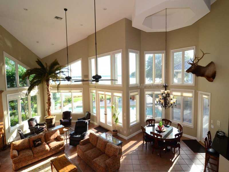 Tall, vaulted ceilings allow large windows in the family room/dining room.