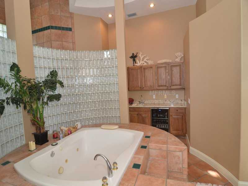 The spa tub is steps away from your favorite bottle of wine or mixed drink since the room features a bar.