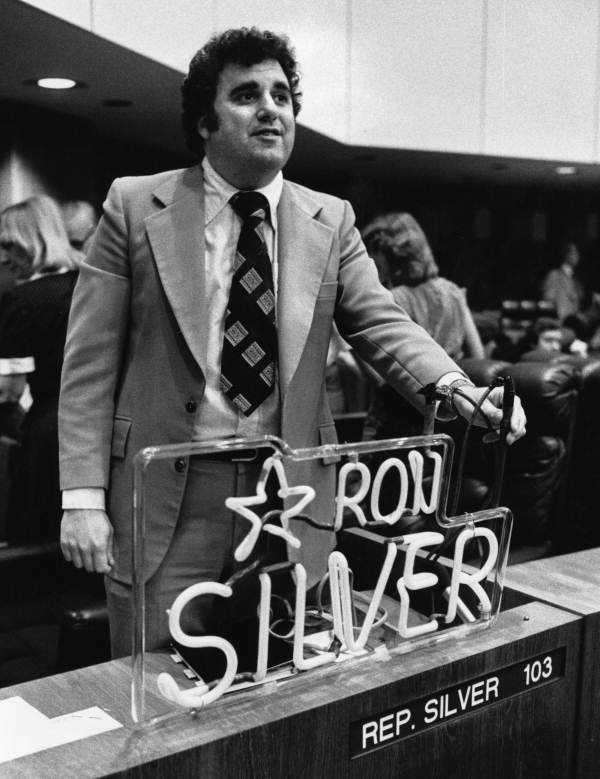 Rep. Ron Silver poses with a name sign.
