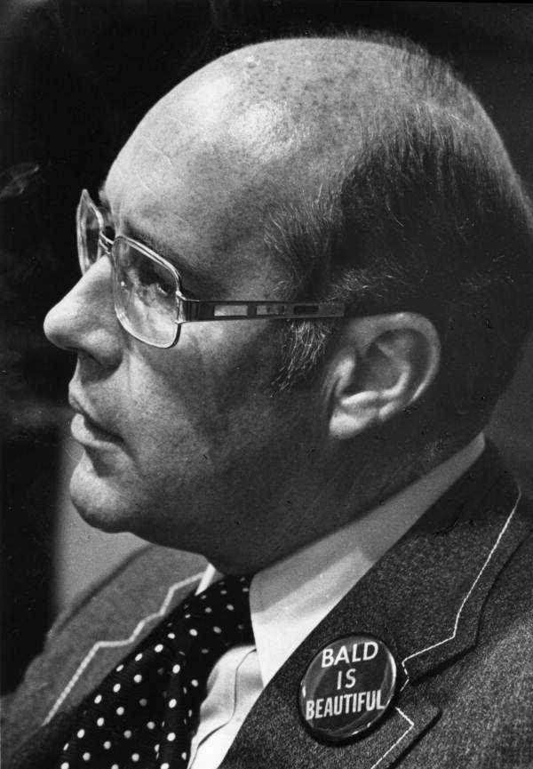 "Senator David Lane wearing a ""Bald is Beautiful"" button."