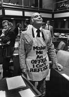 Representative Tony Fontana wears a apron.