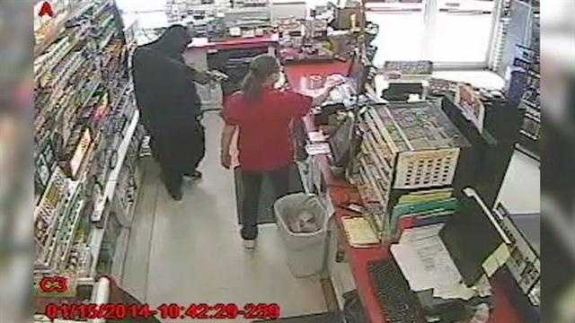 Surveillance video shows an armed man jumping the counter at the Kangaroo Express on Main Street in Mims on Wednesday.