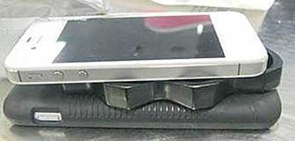 Brass knuckles were found taped between two cellphones.