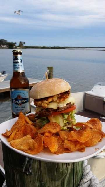 6. Hidden Treasure, located in Port Orange, has a menu full of seafood options including their hand patted 1/2 lb 100% fresh ground chuck burger is seasoned and grilled to order with melted American cheese and topped with a 1/4 lb Maryland style lump crab cake nested in a potato flour dusted bun with fresh onion, shredded leaf lettuce, pickle stackers, house remouade sause and tomatos, stacked tall and served with their home made hickory dusted potato chips.