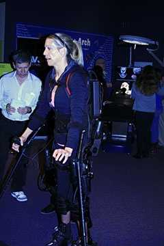 Sarah Anderson, a paraplegic, demonstrating the use of the Ekso Bionic Suit.
