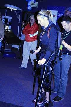 Sarah Anderson shows audiences how the Ekso Bionics suit really works.