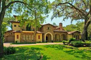 Begin a tour of this 5 bedroom, 7 bathroom estate, inspired by the Italian Tuscan farm houses.