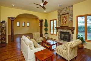Fantastic family room with floor-to-ceiling stone fireplace and wood mantle.