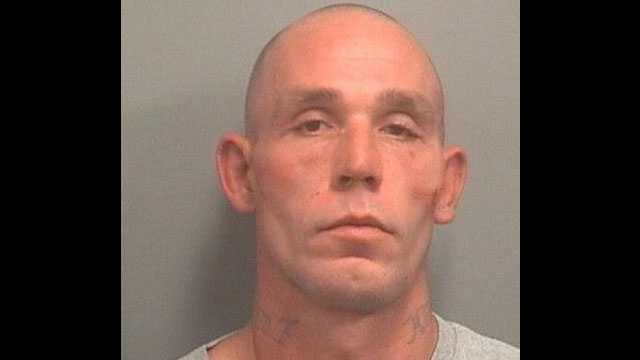 Christopher Gibson is accused of leaving a pit bull outside to die in the heat.