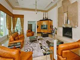 Modern decor is featured in the family room designed around a fireplace.
