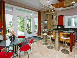 The house has a contemporary bar area and kitchenette.