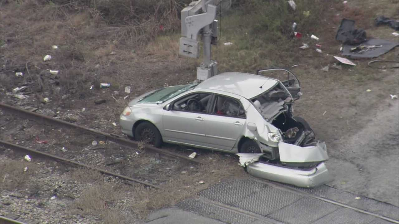 A child and a woman were taken to the hospital after an Amtrak train and a car collided in Taft on Monday afternoon.