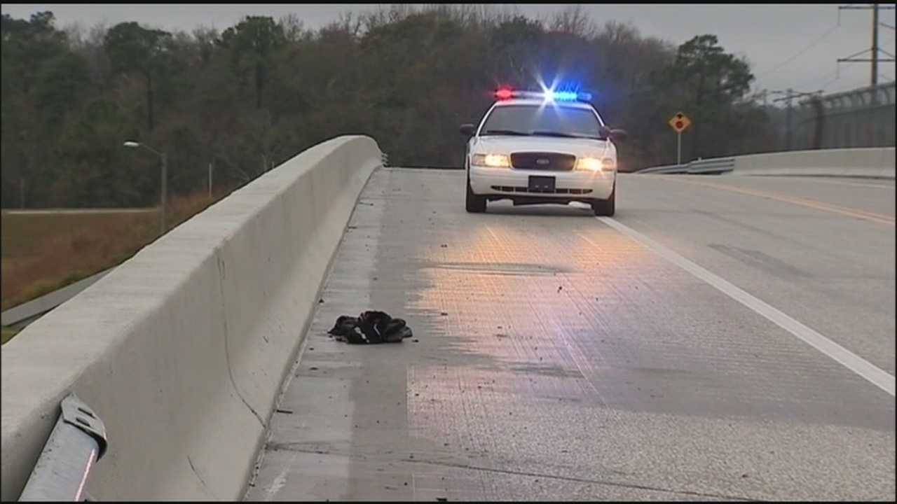 The Florida Highway Patrol said it's not sure if a driver who caused an accident on Interstate 95 jumped or accidentally fell to his death from a nearby overpass.