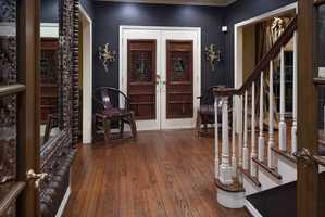 A bold color selection and regal accents create a formal foyer.