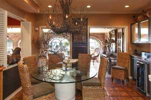 A wet bar, butler's pantry and dining area are all adjacent to the kitchen.