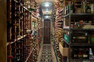 Wine anyone? A sprawling wine cellar stores and chills 6,000 wine bottles.