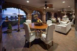 The arched, brick-laden summer kitchen and dining area.