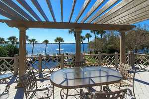 Relax on the deck overlooking sparkling Lake Conway.