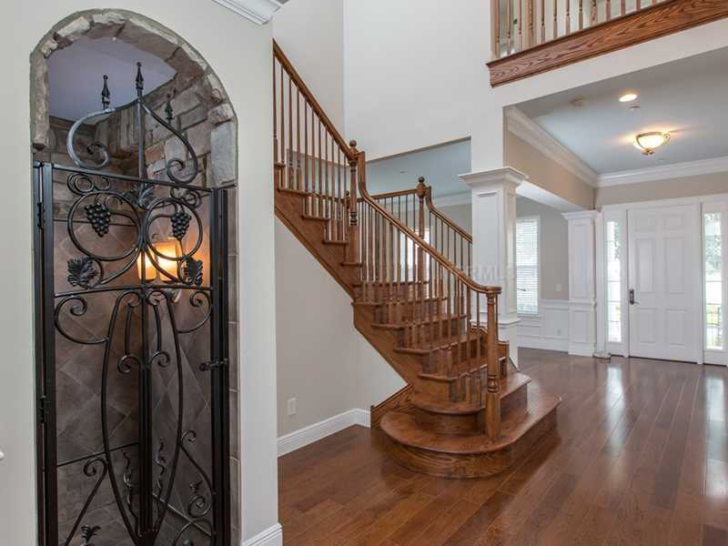 As soon as you walk through the front door your eyes are instantly greeted by a grand handmade and hand-stained oak staircase.