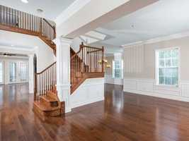 The gorgeous hardwood floors and crown molding are basked in natural light.