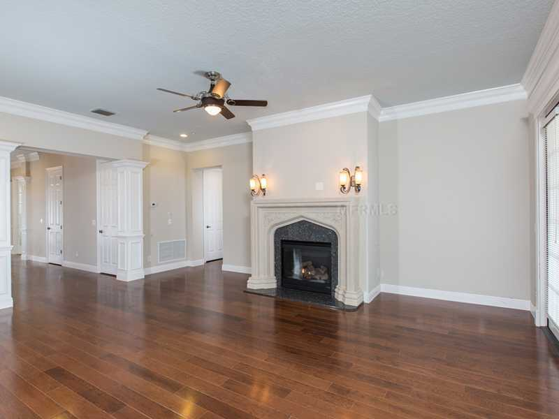 The formal living space is not only spacious, but includes a fireplace.