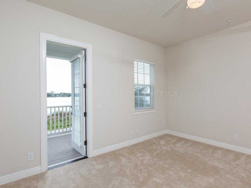 The private entrance and porch in the in-law suite over looks the lake as well.