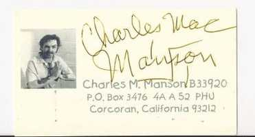 Charles Manson signed business card .  Manson is an infamous American killer: $200