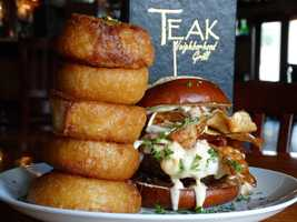 1. Teak Neighborhood Grill: Drunken MonkWhat's on it: Angry Orchard onion jam, roasted cherry tomatoes, smoked bacon, herb mayo, provolone cheese, house made Teak Chips and topped with melted white cheddar cheese. Served on a pretzel bun.See video on Teak's Neighborhood GrilleAddress: 6400 Time Square Ave, Orlando, FL 32835