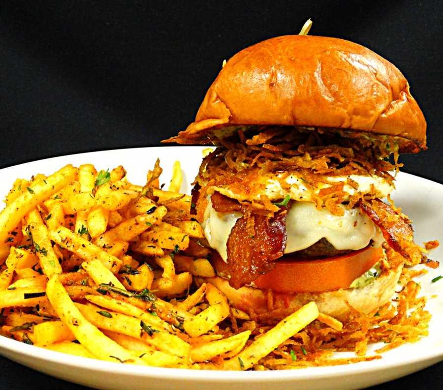 7. RusTeak: RusTeak BurgerWhat's on it: A half-pound Angus beef patty, garlic-herb cilantro sauce, beefsteak tomato, provolone cheese, crisp bacon, fried egg and cristpy potato strings served on a brioche bun.Address:1568 Maguire Road Ocoee, FL 34761