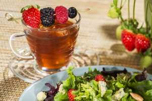 At the Buttercup Cottage Outdoor Kitchen in the United Kingdom pavilion guests can try the berry tea cocktail and a field green and strawberry salad.