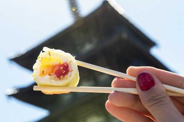 """Grab """"Frushi,"""" made from fresh strawberries, pineapple and melon rolled with coconut rice at Hanami Outdoor Kitchen in the Japan pavilion."""