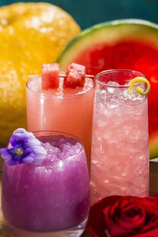"""Non-alcoholic """"mocktails"""" are available at several locations throughout the festival -- (l-r) Frozen Desert Violet Lemonade (Pineapple Promenade Outdoor Kitchen), Watermelon Passion Fruit Slush (Florida Fresh Outdoor Kitchen) and Chilled Rose Blush (The Buttercup Cottage Outdoor Kitchen)."""