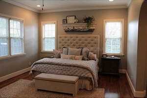 This serene master bedroom is all you need to relax after a long day.
