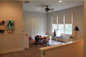 The second floor den has potential to be a sitting area or play den.