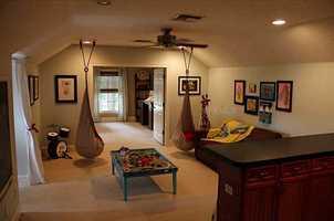 The master bedroom suite includes an adjacent nursery or den area.