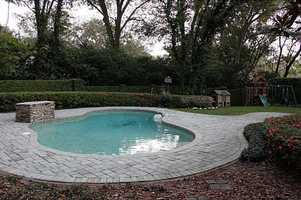 Beautiful outdoor pool and play area.