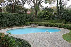 The property sits on 0.35 acres, is in a tree-lined neighborhood and boasts excellent schools in the district. To learn more about this property, visit Realtor.com .