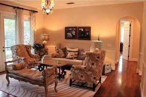 Formal living room accentuates the home's chic country style.
