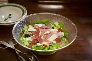 Choose a new topping for Olive Garden's signature garden-fresh salad. Options include Antipasti Italian Meats & Cheeses (pictured) – with hard salami, genoa salami, pepperoni and mozzarella – and Roasted Tomato Caprese – fresh mozzarella bites, roasted tomato, bell pepper, basil, kale and an extra-virgin olive oil drizzle.