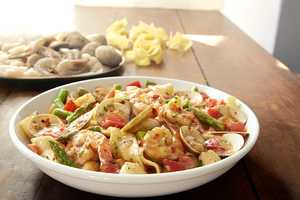 Pappardelle pescatore features sautéed shrimp, bay scallops and clams tossed with pappardelle pasta, fresh asparagus and tomatoes in a creamy red pepper seafood sauce.