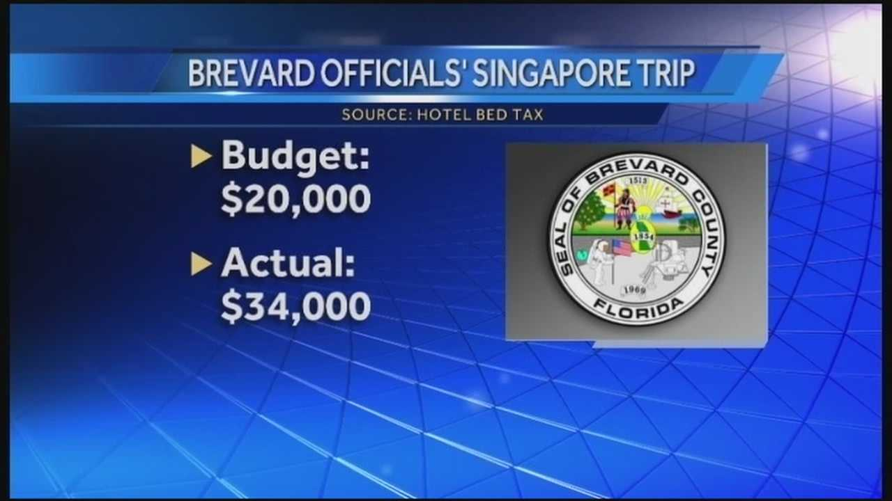 Four high-ranking Brevard County officials are drawing fire for a trip to Singapore that went $14,000 over budget.