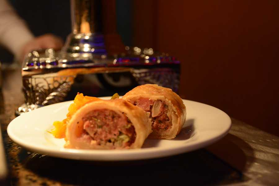 Pork and apple sausage roll with house-made piccalilli: Featured at The Buttercup Cottage located near the United Kingdom Pavilion