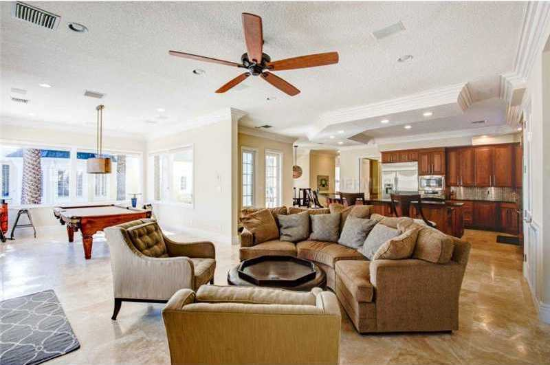 A decked-out lounge includes comfortable seating, a fully-stocked kitchen and pool table.