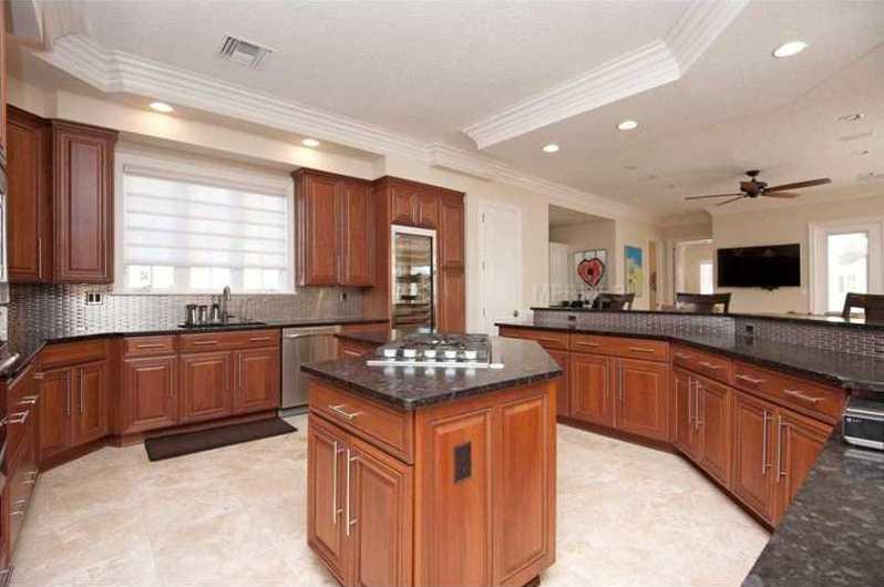 The designer kitchen is minimalist with a grand center island.